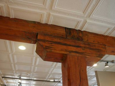A close-up of the exposed wooden ceiling beams and historic tiled ceiling in a Big Lick Junction apartment