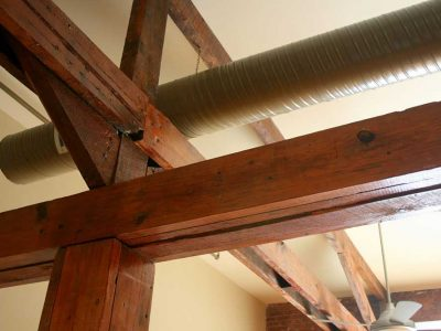 A close-up of the exposed wooden ceiling beams in a Big Lick Junction apartment